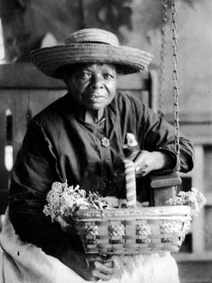 African-American woman in big straw hat, holding basket of flowers, Berea, Kentucky, pre 1931, Doris Ulmann Collection, PH038-13-1608, Doris Ulmann (1882-1934) photographs, 1920s-1934