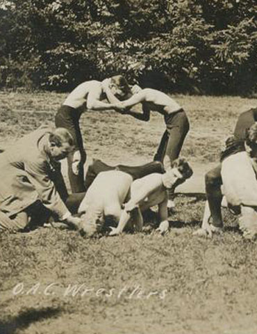 Wrestlers spell out 'OAC,' 1910, Oregon State University Athletics