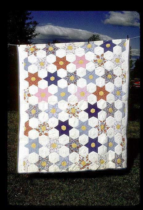65 x 75 star quilt made with feed sack backs and nurses uniforms front, Marguerite Jensen made it, sister was the nurse! Around 1941 or 1942 or so here in Junction City