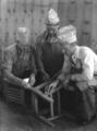 Carpentry Shop, Berea College: three men working on a chair