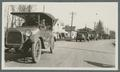 US Army staff car leading truck parade, circa 1920