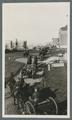 Horse-drawn artillery pieces moving through campus, circa 1920