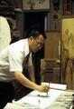 Wing K. Leong doing sumi painting in his studio